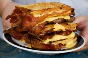 The Double Bacon Hamburger Fatty Melt  Three bacon-stuffed grilled cheese sandwichs for buns, cheese, bacon and two four-ounce beefs patties.
